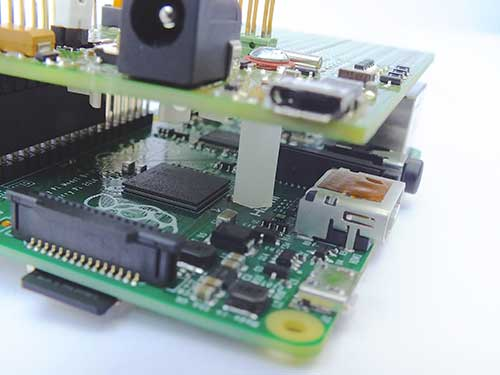 Sleepy Pi sitting on a Raspberry Pi B+ showing use of a stand-off.